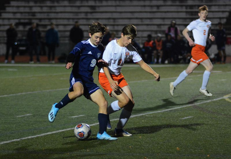 PMG PHOTO: DEREK WILEY - Wilsonville sophomore Toshi Kondo battles for possession against Scappoose.