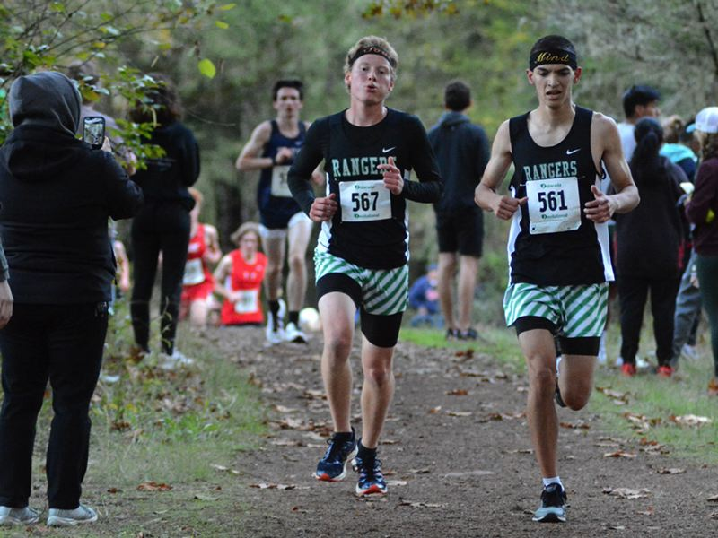 PMG PHOTO: DEREK WILEY - Estacadas Jed Shaver (left) and Zach Blackwell navigate the McIver Park course last week. Nine of 10 Ranger runners finished the day with personal-best times.
