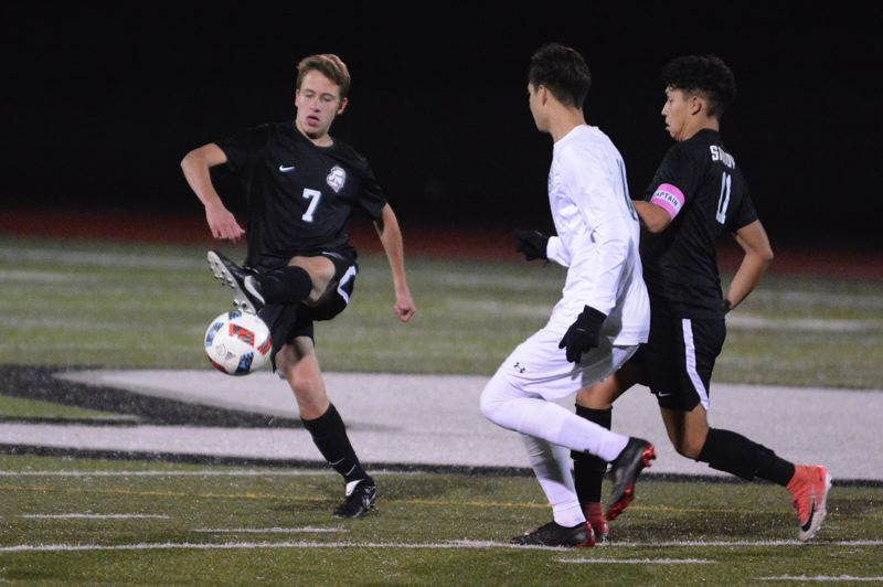 PMG PHOTO: DAVID BALL - Sandys Theo Brinkman looks to clear a ball to the side during Thursdays 5-0 home loss to Reynolds.