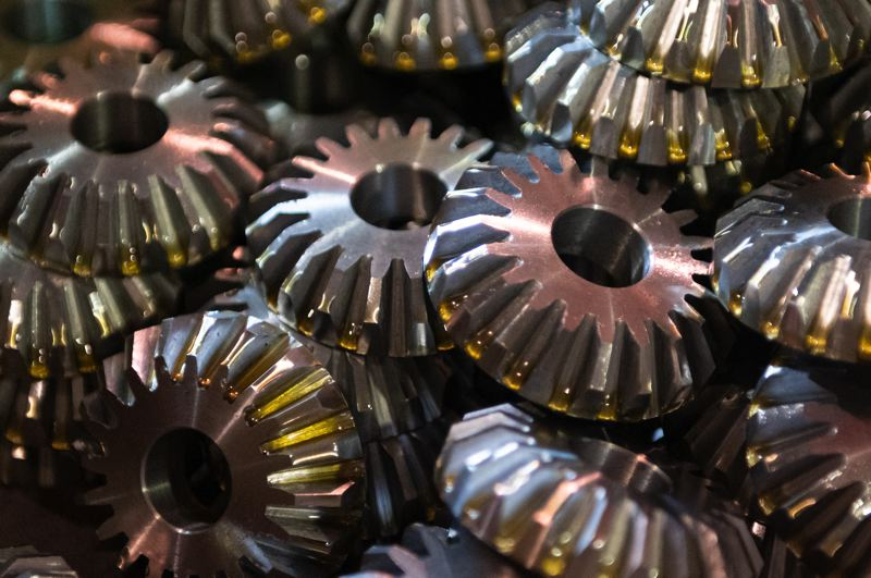 PAMPLIN MEDIA GROUP: CHRIS OERTELL - Finished beveled gears sit in a box.