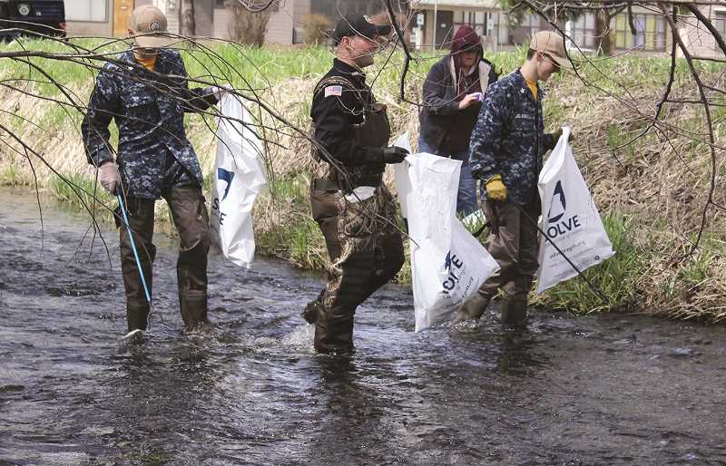 CENTRAL OREGONIAN - Officer James Young (second from left) is expected to participate in the clean-up again.