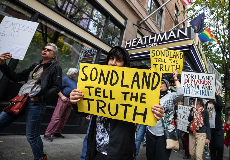 PMG PHOTO: JONATHAN HOUSE - Activists rallied Sunday at the Heathman Hotel, where they urged co-owner Gordon Sondland to testify truthfully in the Trump impeachment inquiry.