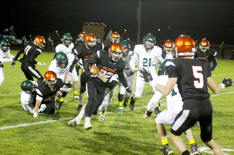 STEELE HAUGEN - Ben Nanez breaks through a Colton tackle during the Bulldogs' 29-6 homecoming victory Oct. 10. Nanez had 24 rushing yards on three carries.