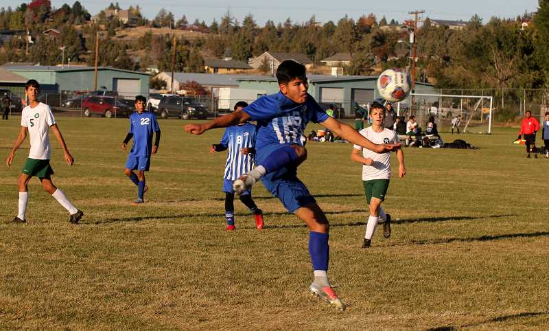 STEELE HAUGEN - Yehir Aguirre attempts to kick the ball out of mid-air during the Buffs' 4-0 win over Estacada Oct. 9.