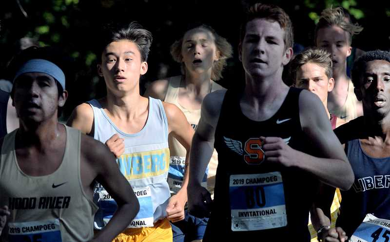 GRAPHIC PHOTO: GARY ALLEN - NHS' Asher Tatsumi finished fifth in the 5,000-meter race at the Champoeg Invitational on Thursday with a time of 16:29:04.