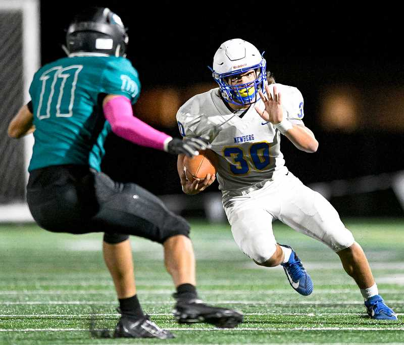 PMG PHOTO: CHRISTOPHER OERTELL  - Sophomore running back Price Pothier makes a cut in the Tigers' win over Century last week.