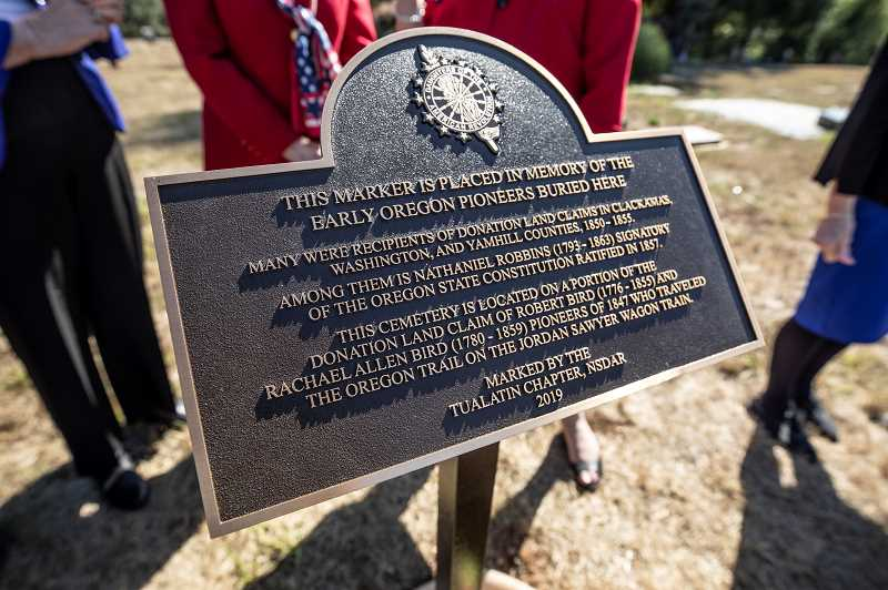 REVIEW PHOTO: JONATHAN HOUSE - A closer look at the new plaque at the Robert Bird Pioneer Cemetery, from the Daughters of the American Revolution.