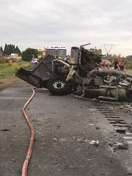 COURTESY PHOTO: OREGON STATE POLICE - The two occupants of the parked Semi, Gagandeep Singh and Baljit Singh of California, were outside their truck during the collision and were uninjured. The driver of the southbound truck,  Rex Hollopeter, was transported  by air ambulance to Legacy Emanuel Medical Center in Portland for serious injuries.