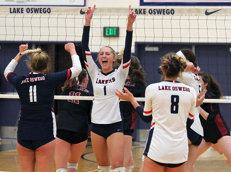 PMG PHOTO: MILES VANCE - Lake Oswego senior Jordan Noble celebrates a point during her team's three-set sweep of Tualatin at Lake Oswego High School on Thursday, Oct. 11.