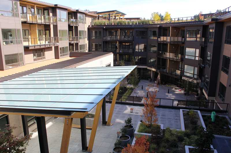 PMG PHOTO: CLARA HOWELL  - The Lake Oswego building has ample outdoor and patio space for residents.