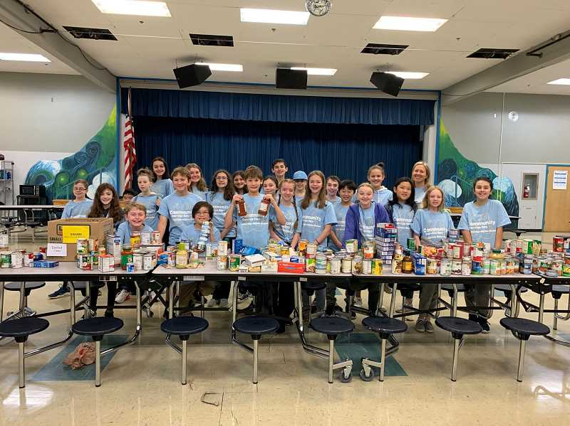 COURTESY PHOTO - Lakeridge Middle School students sorted and delivered food to the local Hunger Fighters Oregon food pantry.
