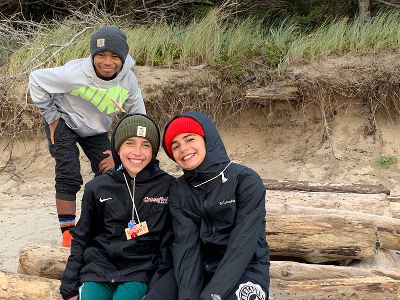 COURTESY PHOTO - LOJ students Payton Harrison (in back), Hannah Page and Sofie Ciporen relax on the beach during Outdoor School.