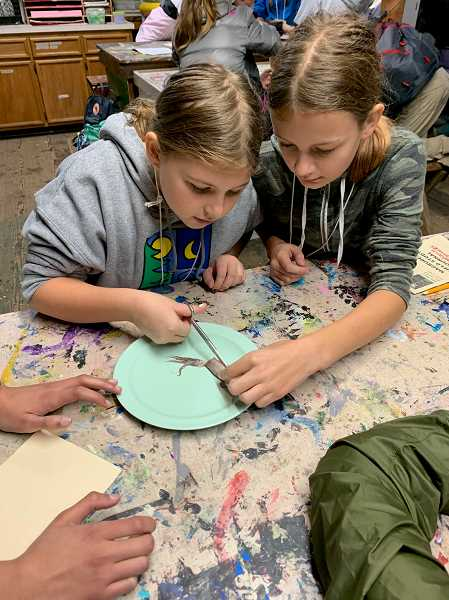 COURTESY PHOTO - LOJ sixth graders Ashlyn Fleming and Maddison Hammel dissect the inner-workings of a squid.