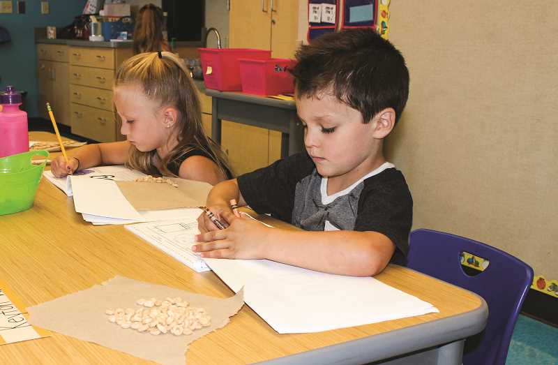 PHOTO COURTESY OF CROOK COUNTY SCHOOL DISTRICT  - Kindergarteners Piper Watson (left) and Keyton Walker complete some work during the school day. The listening sessions planned for next week are intended to gather public input on how to improve schools from kindergarten through high school.