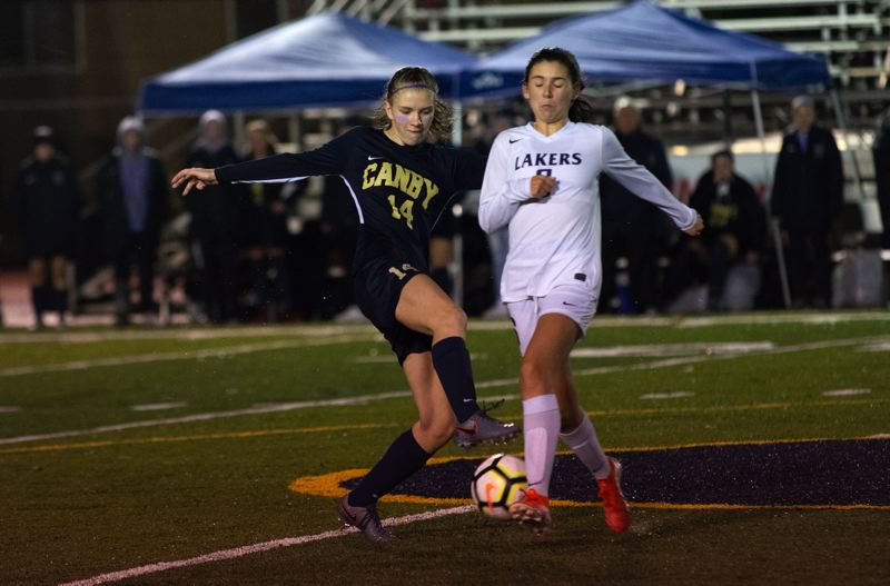 PMG PHOTO: DEREK WILEY - Canby sophomore Makena Speer scored one of the Cougars three goals Thursday night against Lake Oswego.