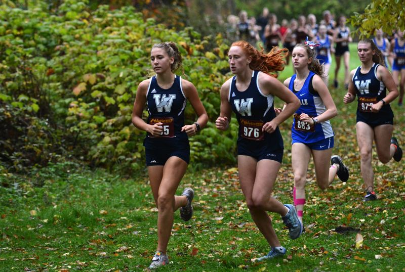 PMG PHOTO: DEREK WILEY - Wilsonville runners Gabriella Prusse and Sydney Burns finished second and third Wednesday at North Clackamas Park.