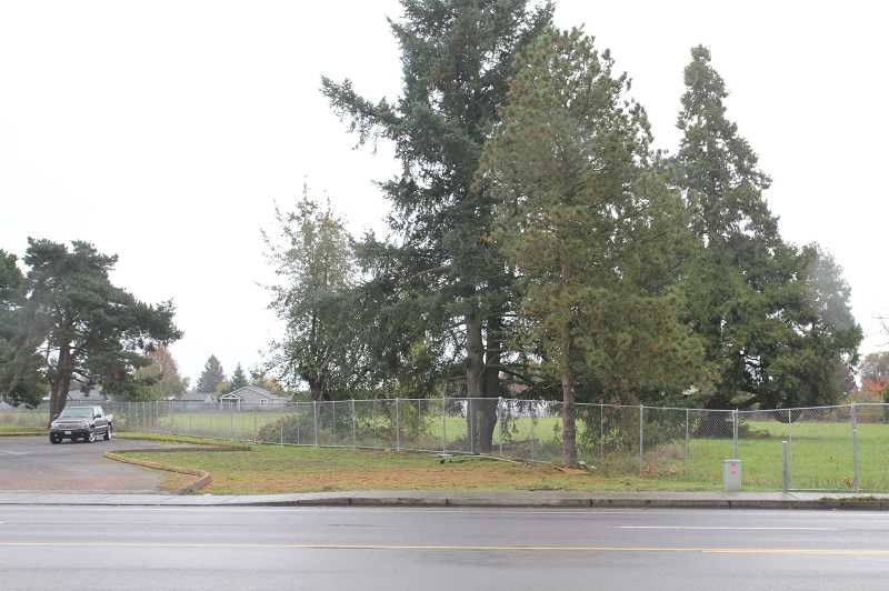 PMG PHOTO: JUSTIN MUCH - Some residents on Woodburns Greenview Drive, a quiet neighborhood with single-family homes that runs parallel to Highway 99E, are concerned that a 3-story apartment complex proposed for 1300 block of 99E could affect the value of their homes.