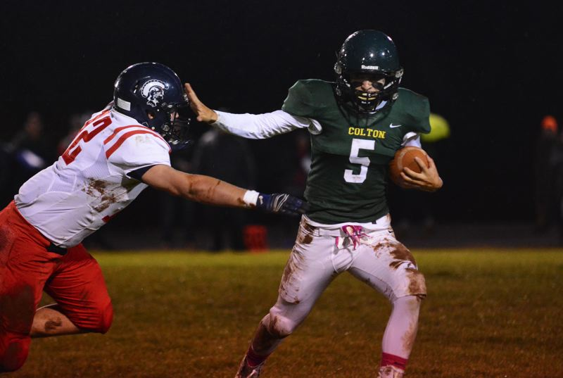 PMG PHOTO: DEREK WILEY - Colton senior Wyatt Earls carries the ball against Kennedy Friday night.