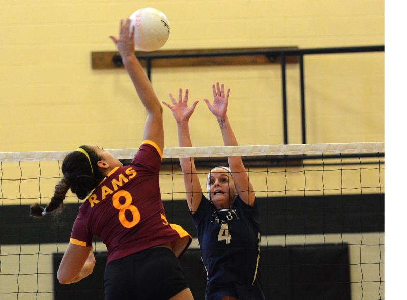 PMG PHOTO: DEREK WILEY - Canby senior Ruby Kayser tries to block a shot at the net against Central Catholic Saturday at West Linn High School.