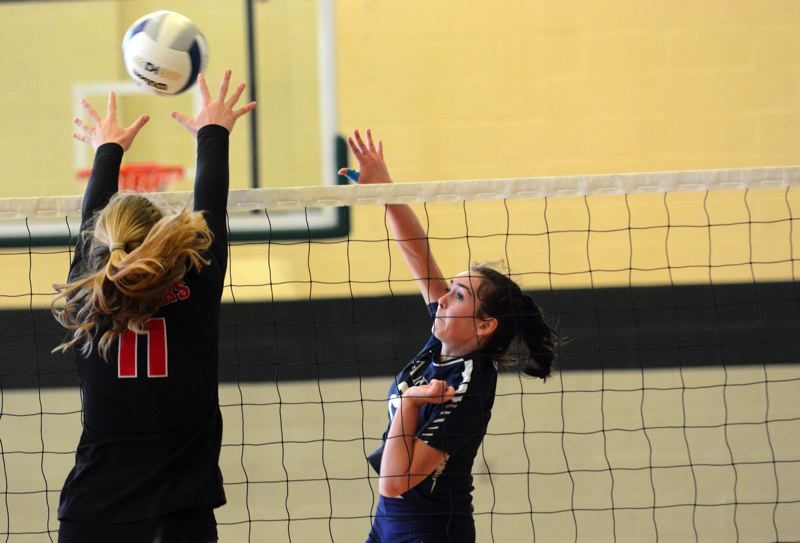 PMG PHOTO: DEREK WILEY - Canby junior Caitlin Gay hits the ball over the net Saturday against Oregon City.