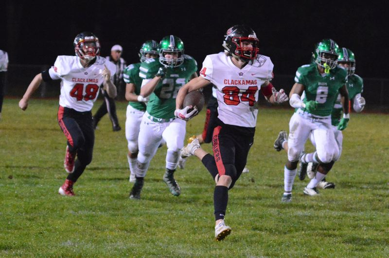PMG PHOTO: DAVID BALL - Clackamas Nick Kennewell breaks into the open field for an 88-yard kickoff return in the first quarter.