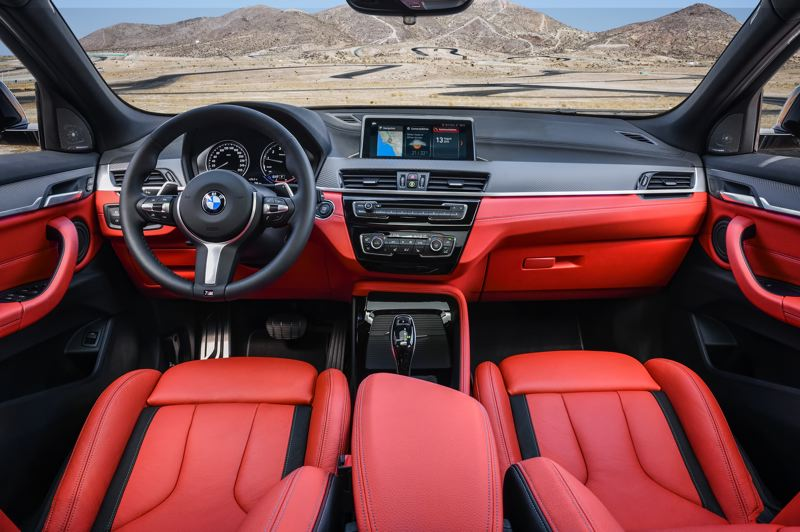BMW OF NORTH AMERICA - The eye-popping Magna Red Dakota Leather interior livens up the tradtionally restrained BMW interior in the X2 M35i.