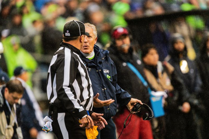 MICHAEL WORKMAN PHOTO - Seattle Seahawks coach Pete Carroll has a discussion with a referee during Sunday's NFL game vs. Baltimore.