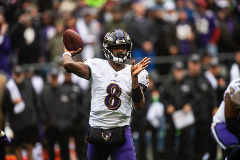 MICHAEL WORKMAN PHOTO - Lamar Jackson of Baltimore has time to wind up and deliver a pass.