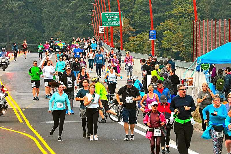 DAVID F. ASHTON - Here are some of the five thousand 2019 Portland Marathon runners, here heading east across the Sellwood Bridge.