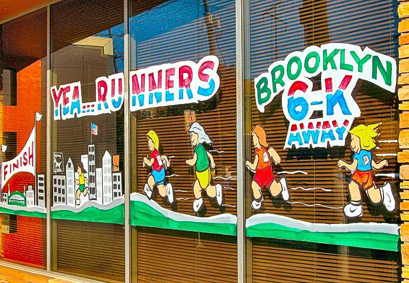 RITA A. LEONARD - Brooklyn merchants threw themselves into the Cheer Challenge contest - as shown by this mural painted temporarily on the front of Rainbow Painting, 4126 S.E. Milwaukie Avenue, to encourage the passing Portland Marathon runners.