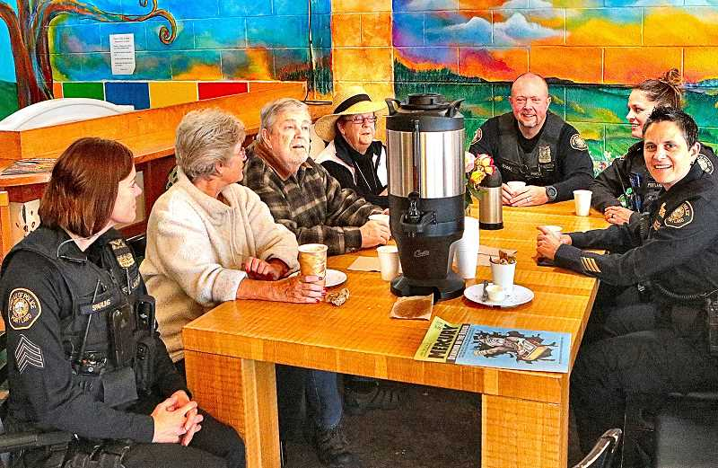 DAVID F. ASHTON - At this Coffee with a Cop gathering, East Precinct police officers, and Commander Tashia Hager (seated far right), talked with neighbors at Woodstock Boulevards Papaccinos Coffee House & Cereal Bar.