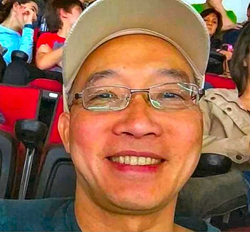 COURTESY OF KOIN-TV-6 - This family photo shows Hoang Minh Tran - a Franklin High counselor who perished in an apparent coastal boating accident, on the last weekend of September.