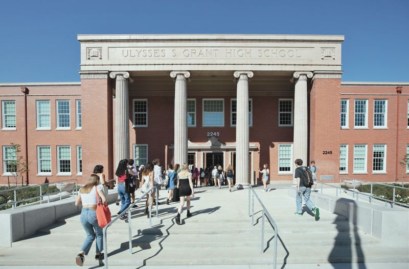 PMG PHOTO: JONATHAN HOUSE - Grant High students filter into the newly renovated building on the first day of school.