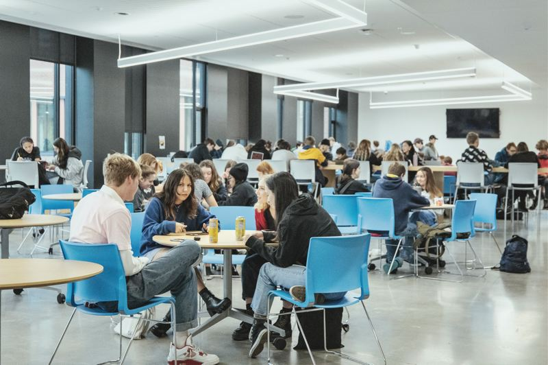 PMG PHOTO: JONATHAN HOUSE - Students hang out in a common area at Grant High School.