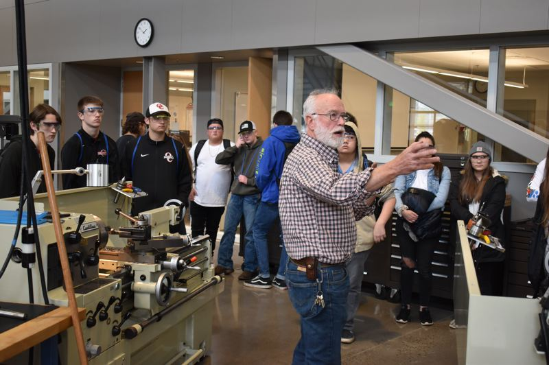 PMG PHOTO: RAYMOND RENDLEMAN - Craig Anderson, a Clackamas Community College manufacturing teacher for the past 17 years, leads a group of Oregon City High School students through CCCs Industrial Technology Center.