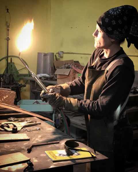 COURTESY PHOTO - Sculptor Shelly Durica-Laiche wields a blowtorch as she works with steel, which transforms from inflexible to liquid when heated.