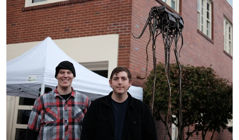 COURTESY PHOTO - 'Forged Grace,' was created by Truax Designs, including Mark Boehly, left, and Skyler Null; Christopher Truax (not pictured) was the art director.
