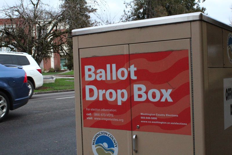 PMG PHOTO: MARK MILLER - Washington County maintains an official ballot drop box on the south side of Pacific Avenue outside the Forest Grove City Library, among several other locations.