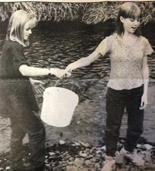 CENTRAL OREGONIAN - OCTOBER 20, 1994: Sarah Mayfield and Lindsay Khile watered their freshly planted Black Locust trees with a few gallons of Ochoco Creek water. Students planted the trees yesterday as part of Dave Boucher's class at Crook County Middle School.