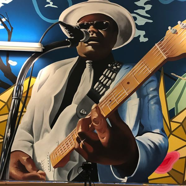 COURTESY PHOTO: ALEX CHIU - Famed local bluesman Norman Sylvester is featured in a new mural at PDX in the north pedestrian tunnel.