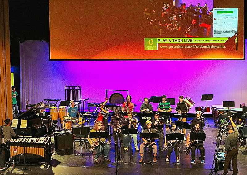 DAVID F. ASHTON - During this years Cleveland High October Play-a-thon, the Cleveland High Jazz Ensemble entertained, while the screen above them shows the progress of their fundraiser.