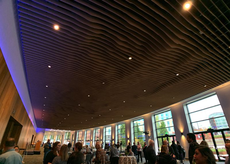 PMG PHOTO: JAIME VALDEZ - The renovation of the Oregon Convention Center includes a unique ceiling treatment in a pre-event space outside the Oregon Ballroom. The treatment is a topographical representation of the Cascade Mountain range.