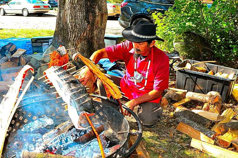 DAVID F. ASHTON - Tending the fire at the traditional Salmon Bake was Clifton Bruno (Wasco-Columbia River).