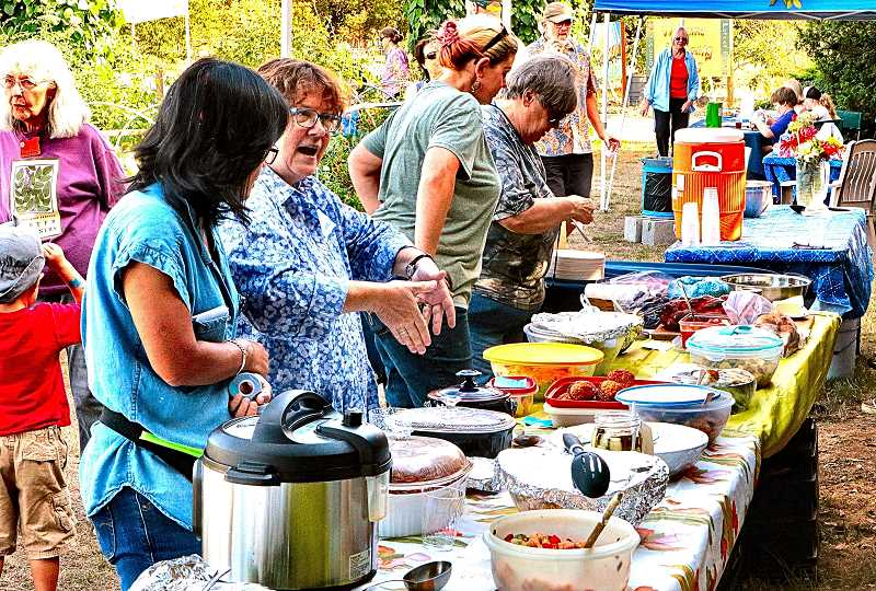 DAVID F. ASHTON - Many dishes, created with their own fresh-from-the-garden produce, lined the serving table at this years Multnomah County Master Gardeners Harvest Fest, on S.E. 60th Avenue.