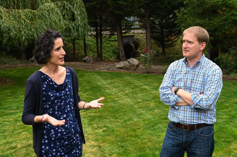 PMG PHOTO: CHRISTOPHER OERTELL - Kim and Scott Harrington stand in the backyard of their parent's property on Jackson School Road where the City of Hillsboro is planning road improvements that will require cutting 300 trees.