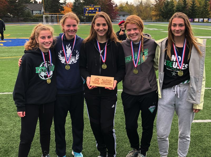 CONTRIBUTED PHOTO - The Estacada girls cross country team poses after their second-place finish at the Aloha Invitational.