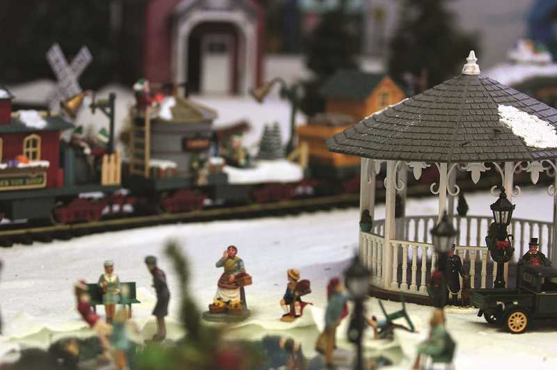 PMG PHOTO: PHIL HAWKINS - The three-story barn that houses Mother Hubbard's Cupboard Bazaar is ornately decorated inside, including nine trains running throughout the building and a Christmas village display downstairs.