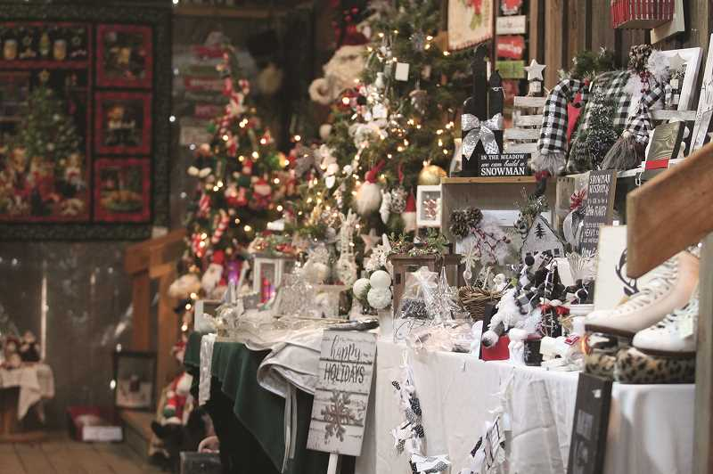 PMG PHOTO: PHIL HAWKINS - It took Lisa Holum and two others less than a week to set up displays for more than 80 vendors. The bazaar gets new shipments of items throughout the week, allowing the selection of goods to be refreshed during the shopping season.