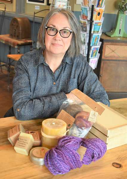 PMG PHOTO: EMILY LINDSTRAND - Larch Mountain Country Artisans member Robin Ceiliani creates a variety of wool, candles and soap.