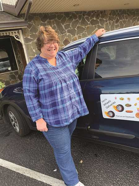 PMG PHOTO: CAROL ROSEN - Laura Ferris started the delivery business with her daughter, but is now out on her own with Ferris Wheel Deliveries, which services Molalla, Colton, Mulino, Marquam, Yoder and parts of Canby.